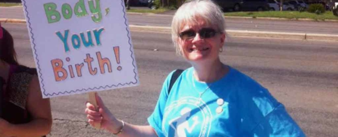 "Robin Rabenschlag at The Purpose rally in 2014 holding a sign that says ""your body, your birth!"" San Antonio midwives"